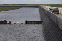 After Hurricane Katrina, the federal government built a 1.8-mile barrier along Lake Borgne, a lagoon of the Gulf of Mexico. (Credit: Lee Celano/AFP/Getty Images/File) Click to Enlarge.