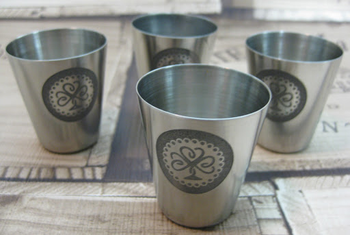 Stainless Steel Shot Glasses Etched with Edinburgh Etch Solution (Ferric Chloride) using Vinyl Resists Cut with Silhouette Cameo.  Tutorial by Nadine Muir for Silhouette UK Blog