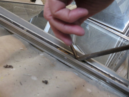 cleaning the screw channel on an aluminum trailer windows