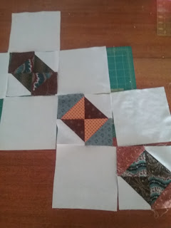 "Three pieces ""hourglass"" blocks for 1850s reproduction quilt."