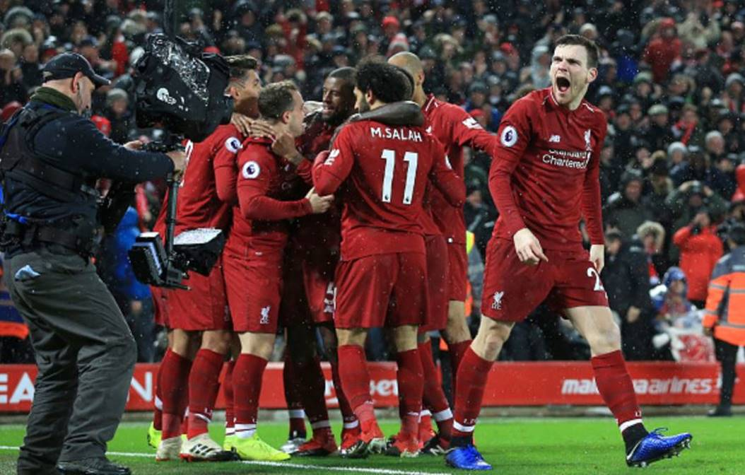 Liverpool-players-celebrate-in-their-3-1-victory-over-Utd