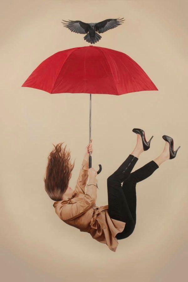 Mujer cayendo con paraguas
