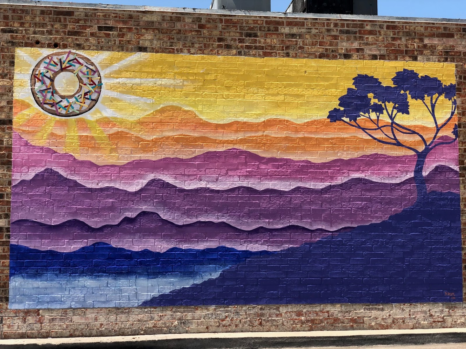 donut sun mural in waco texas on shipleys donuts