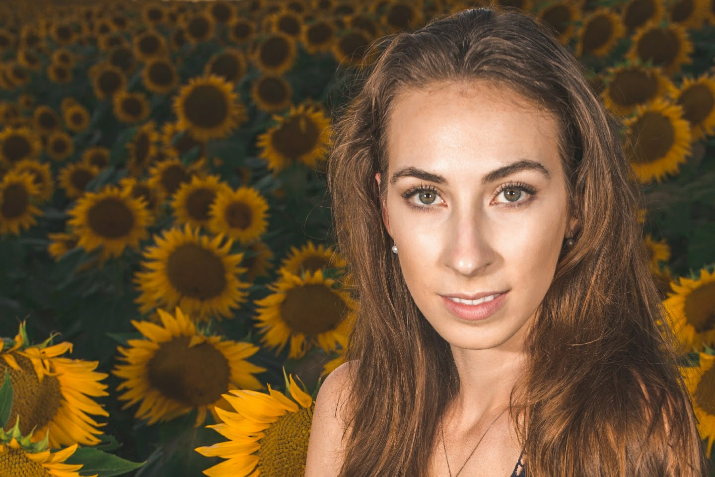 Morgan Pashen headshot in sunflower field