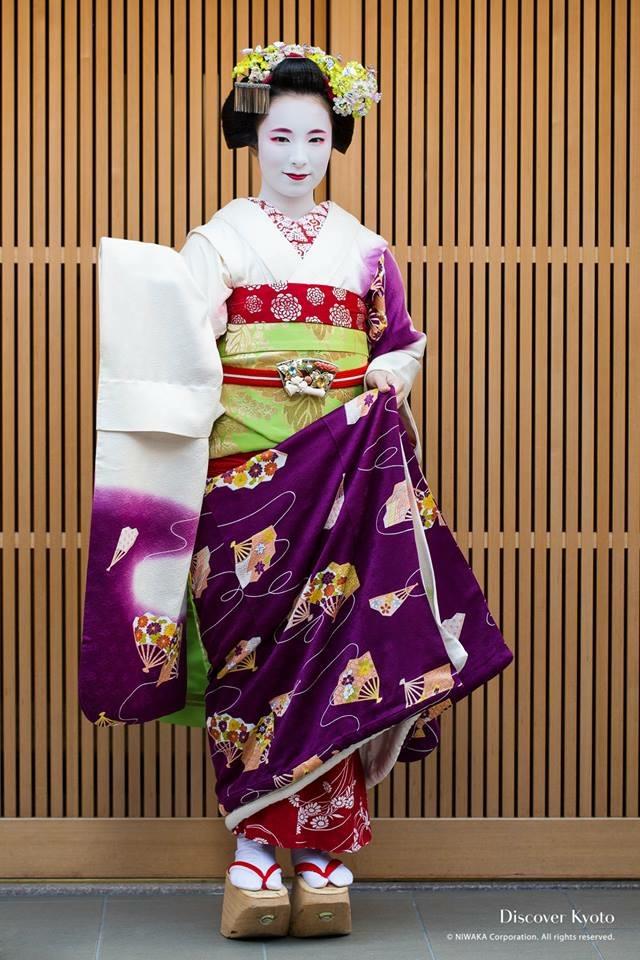 Maiko wears much longer sleeved kimono