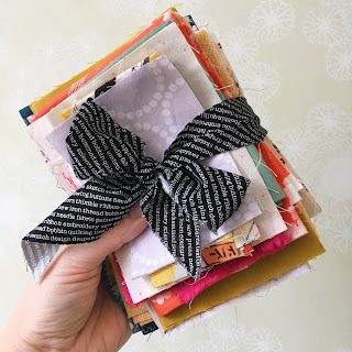 fabric scrap bundle tied up in a bow