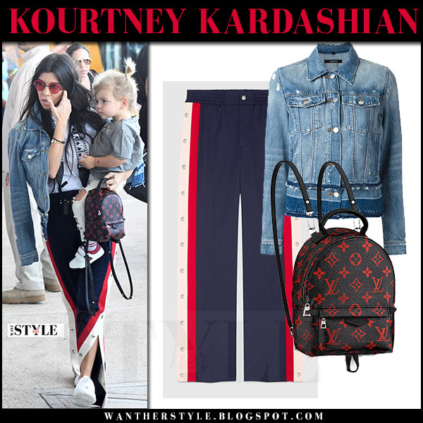 Kourtney Kardashian in denim jacket j brand deena and blue red stripe track pants gucci what she wore