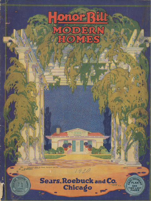 Front of 1920 Sears Honor Bilt Modern Homes catalog, blue background, green foliage on huge white columns, Sears Hollywood model inside the columns