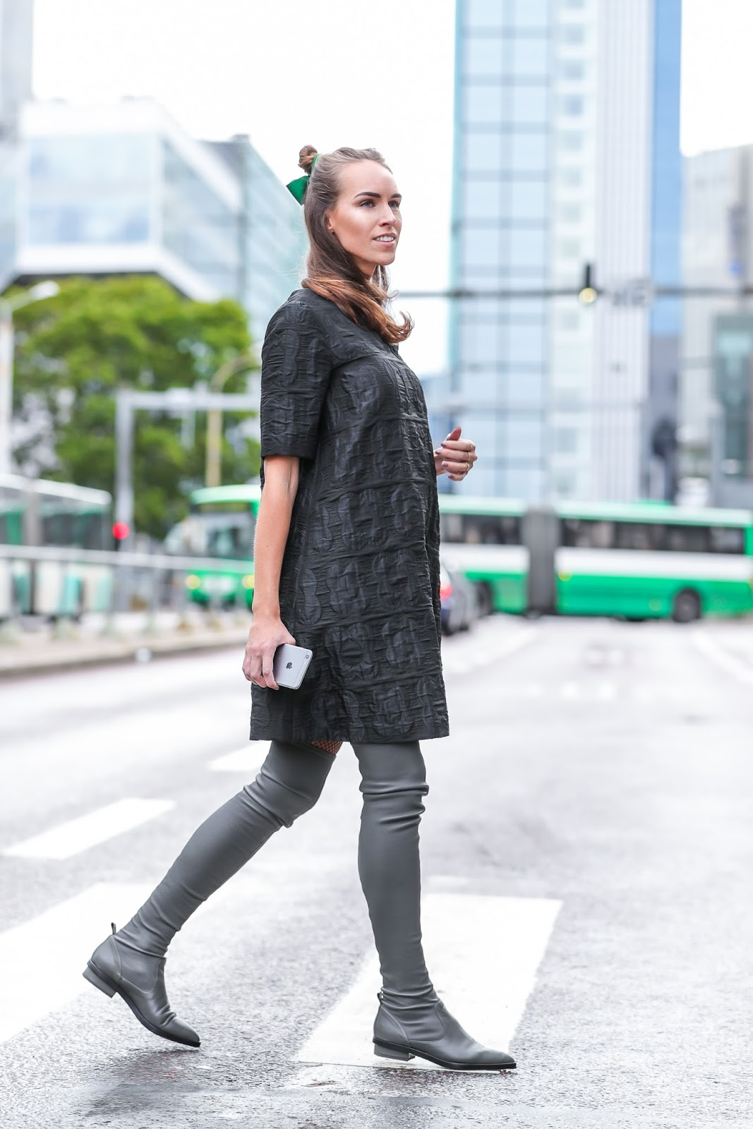 black textured mini dress over knee boots outfit