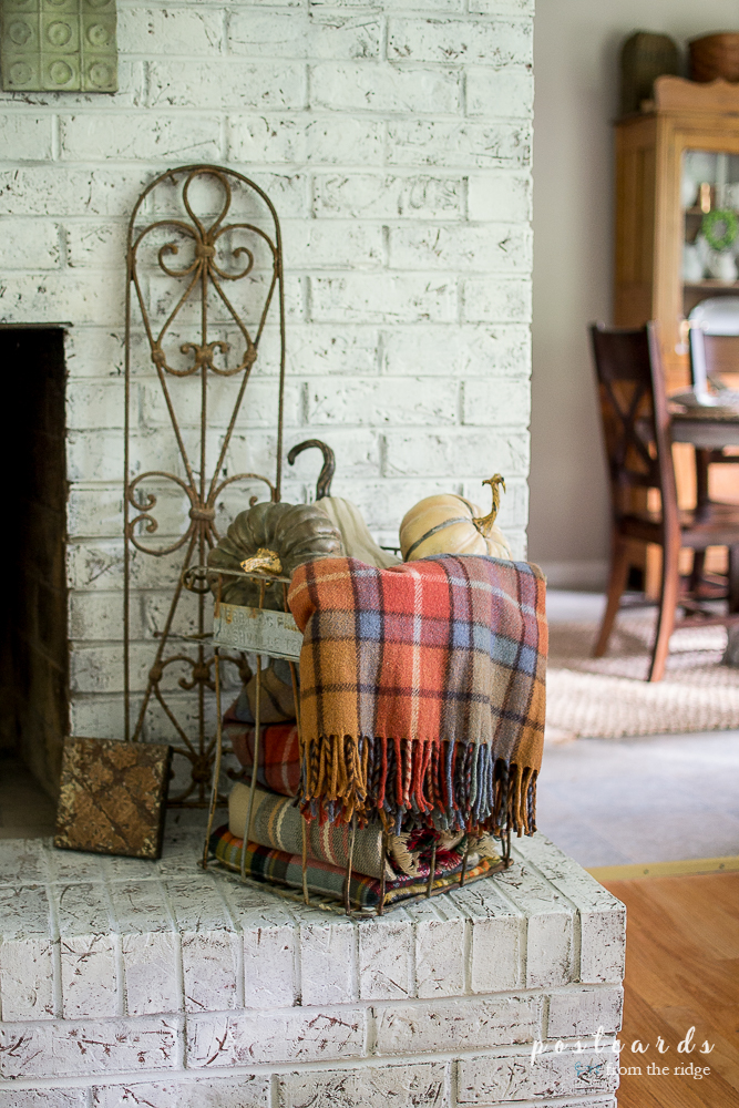 Such a cozy fireplace! Lots of great ideas for French country farmhouse fall decor.