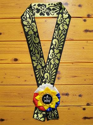 Original design of Kalayan Rosette in a brocade trimming as lei