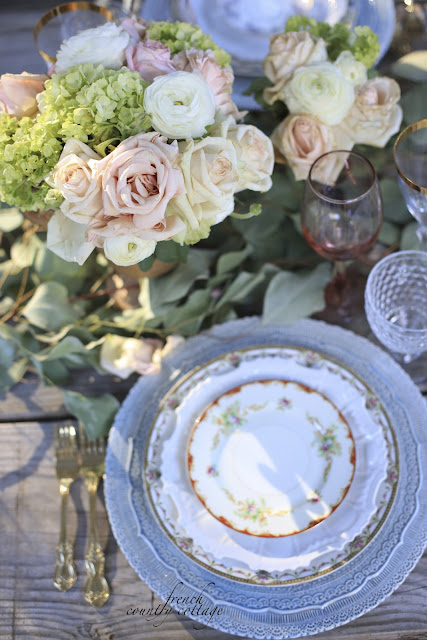 Vintage plates layered on a table