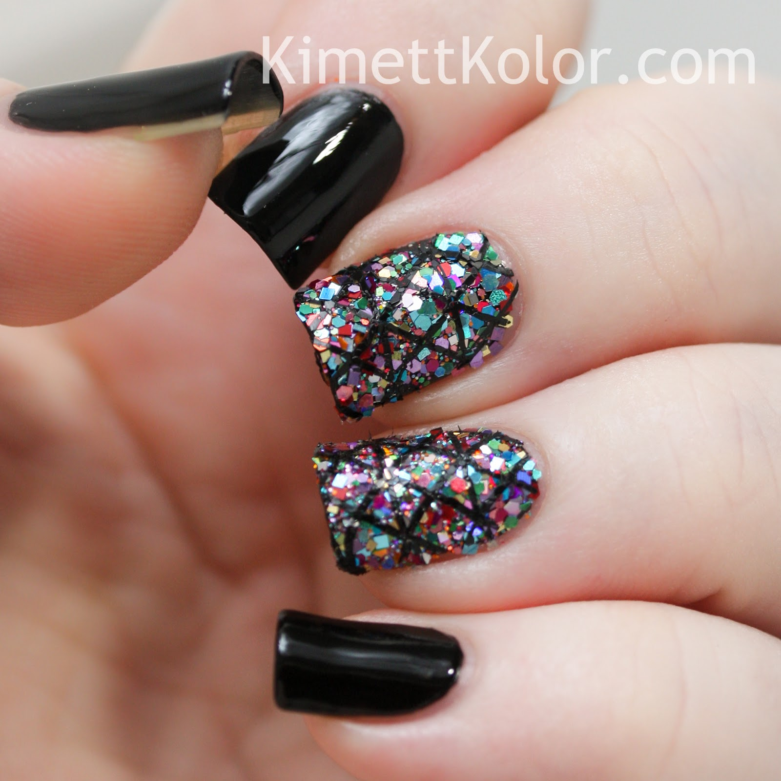 https://www.kimettkolor.com/2014/07/glitter-covered-nailswith-stamping.html