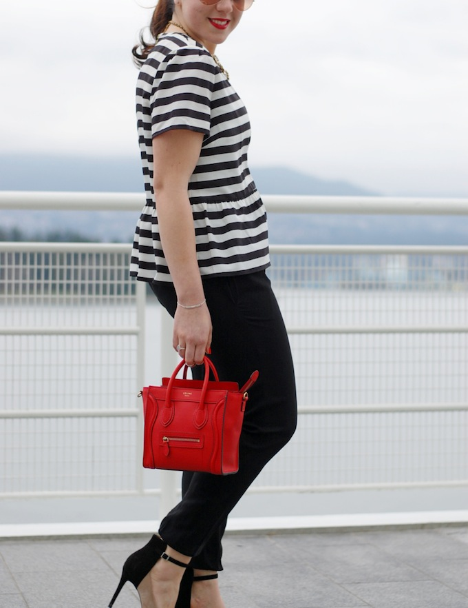 Juicy Couture oversized peplum tee with black and white stripes, Vince silk jogger pants and a Céline Nano handbag Vancouver fashion blogger Covet and Acquire.