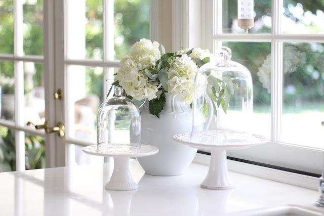 decorating-with-cloches-white-kitchen-hydrangeas