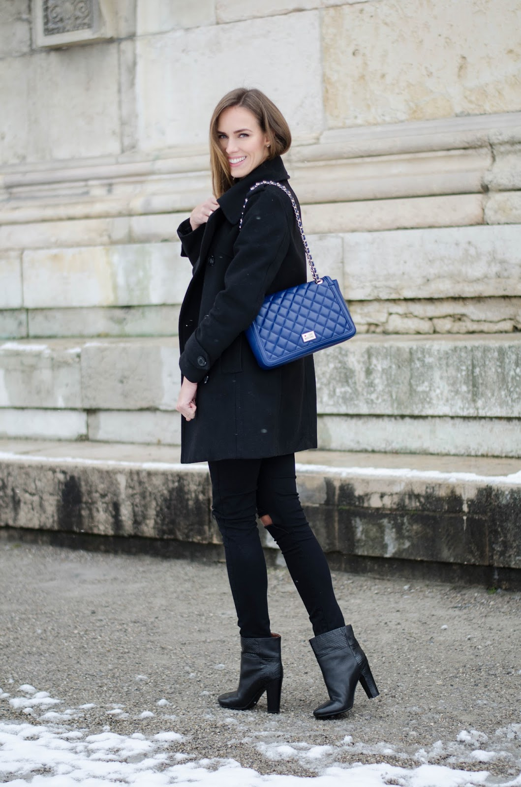 kristjaana mere peacoat black jeans ankle boots blue moschino bag