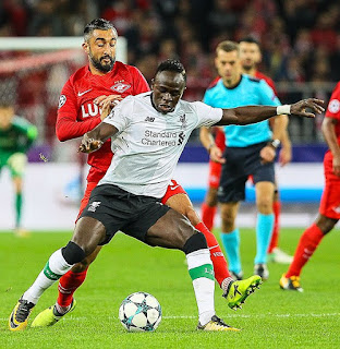 Sadio Mane signs long term deal at Liverpool contract .