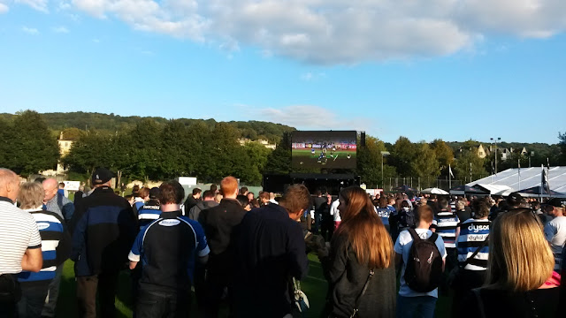 Crowds watching rugby on big screen