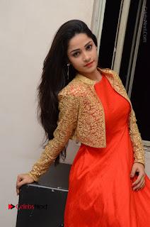 Telugu Actress Divya Nandini Stills in Orange Sleeveless Gown at Chennai Chaitrama Movie le Launch Event  0091.JPG