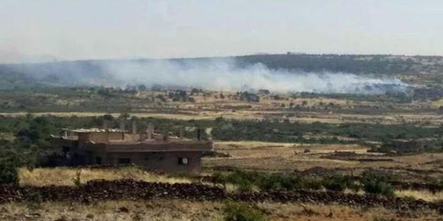إرهابيو النصرة يشعلون النيران بالبساتين الزراعية في قرية حضر بريف القنيطرة