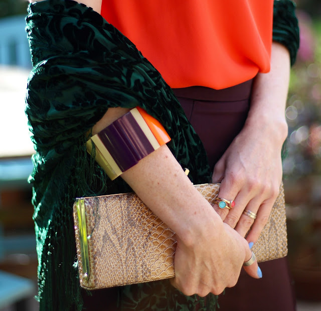 Fake Fabulous | Aubergine satin wide legged trousers, orange camisole, green velvet shawl and heels, nude clutch, over 40.