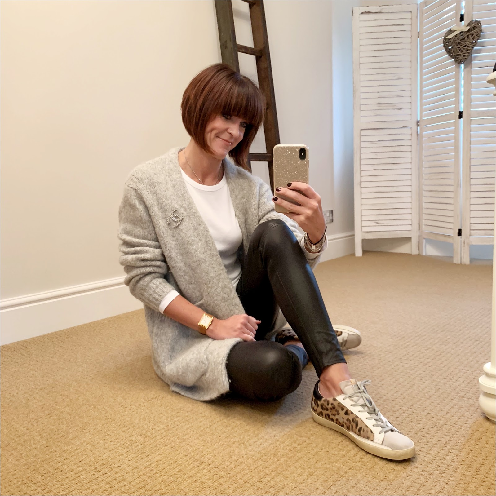 my midlife fashion, acne studios oversized cardigan, marks and spencer pure cotton long sleeve crew neck t shirt, massimo dutti leather leggings, chanel brooch, golden goose superstar low top leather trainers
