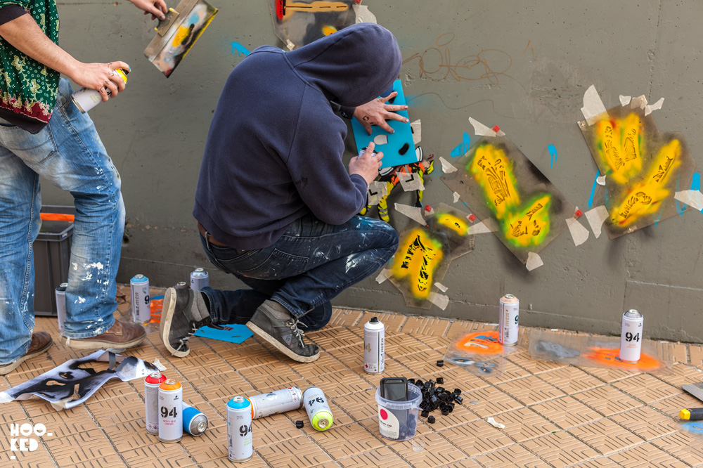 Street Artists OakOak and Jaune at work on a mural in Ostend, Belgium. Photo ©Hookedblog / Mark Rigney