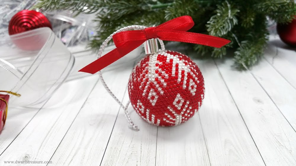 Red crochet beaded holiday decoration with snowflake