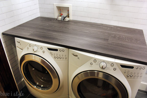 This dark wood-look countertop not only adds function to our small laundry  space, it also makes it look so much more like the finished laundry room I  had ...