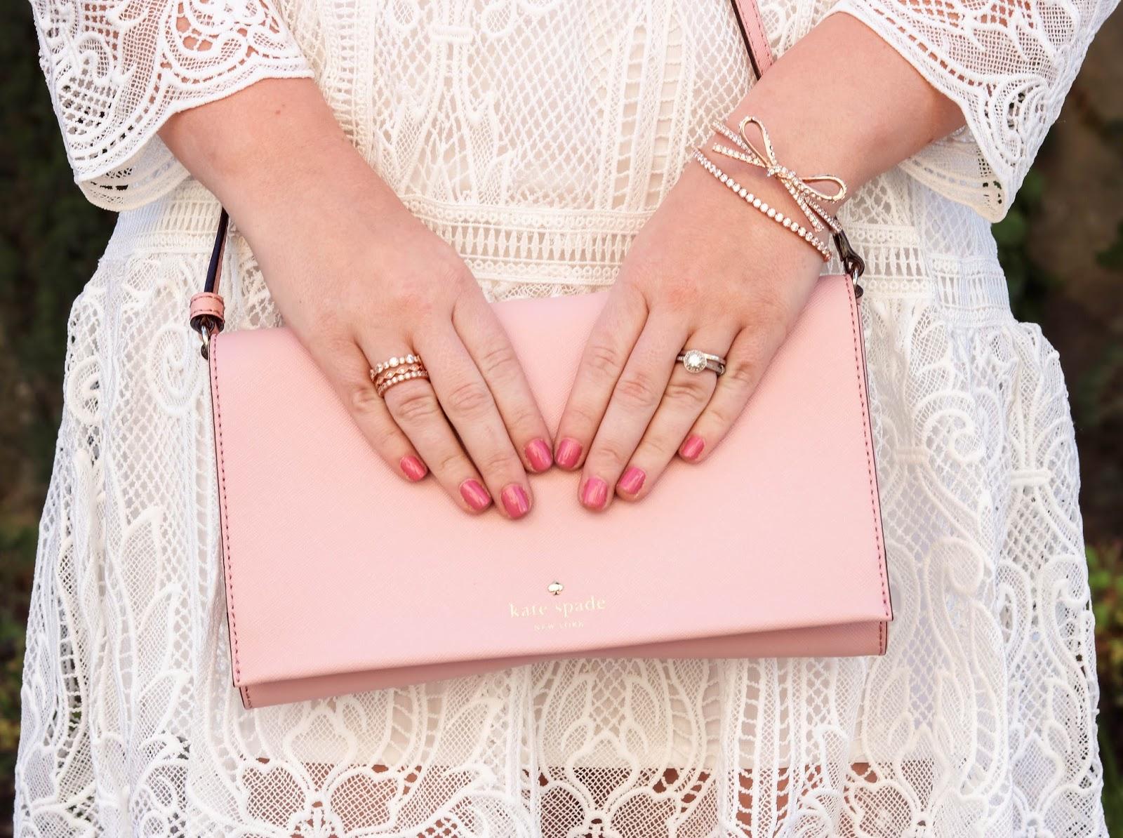 Elizabeth Hugen of Lizzie in Lace styles a pink Kate Spade handbag