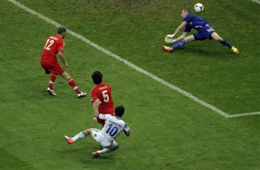 Greece player Giorgos Karagounis scores past Russia goalkeeper Vyacheslav Malafeev