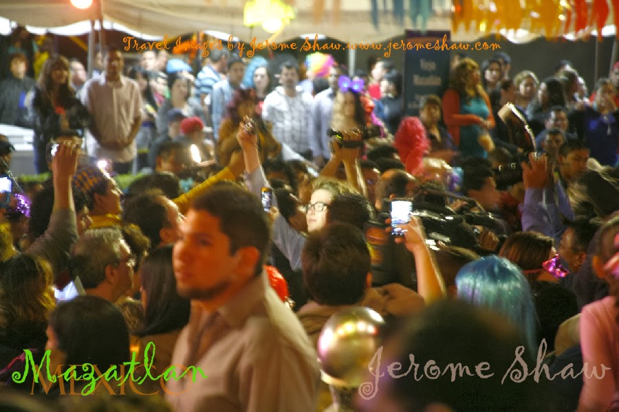 The currents of the crowds on Olas Altas sweep down the street   during Carnival in Mazatlan, Mexico. Photo: Jerome Shaw for TravelBoldly.com