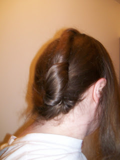 Twisted hair arranged on the back of the head.
