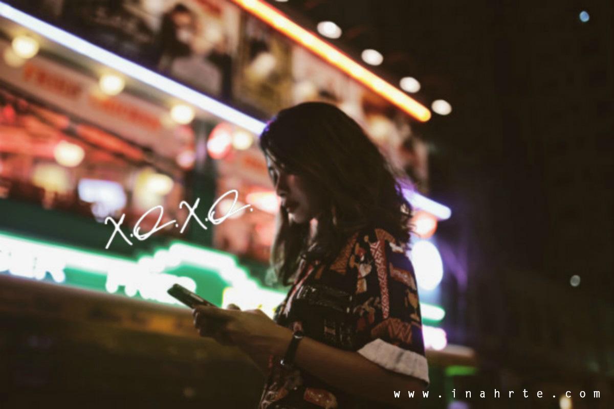 XOXO Using cellphone on the night street