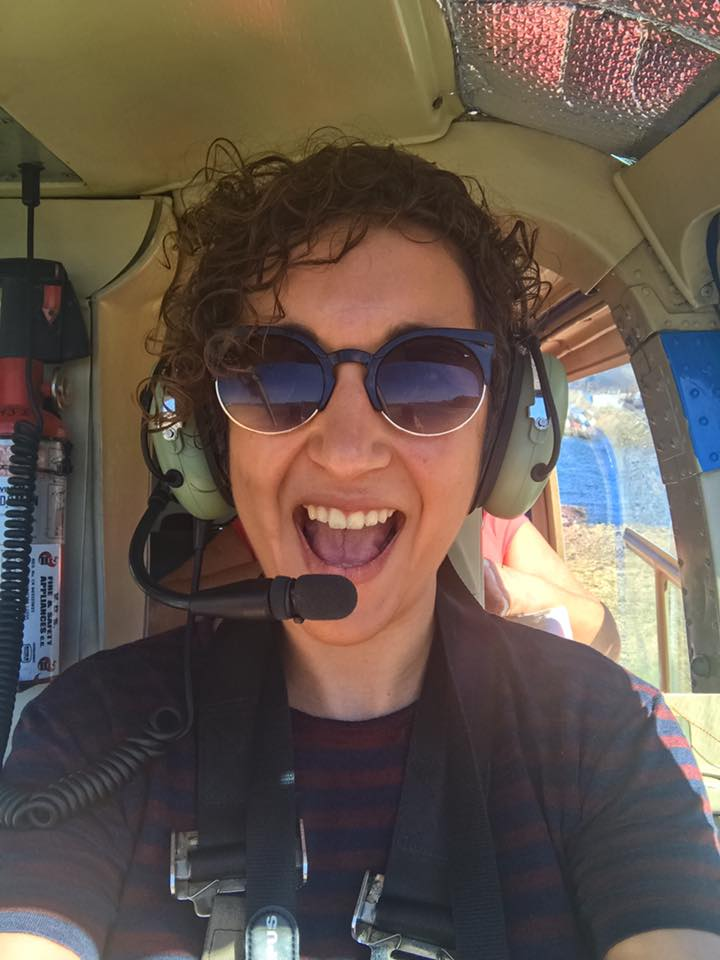 Sitting in the front of a helicopter