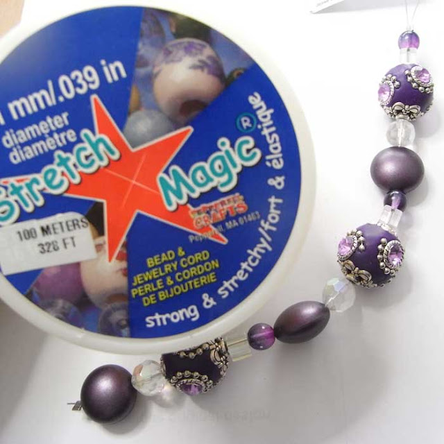 Stretch Magic beading elastic and strand of purple Kashmiri beads