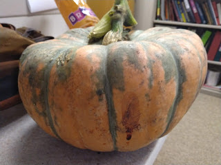 large pumpkin with flat top and green stripes