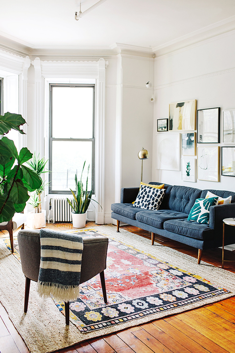 bohemian apartment in brooklyn, houseplants, gallery wall, blue sofa,