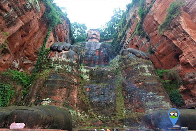Full shot of The Leshan Giant Buddha once getting to the ground from the stairway in Sichuan province of China