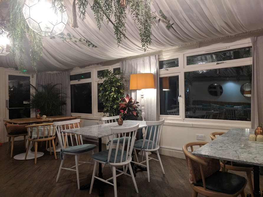 Waterside Cornwall Review | Self-Catering Lodges Near The Eden Project - conservatory restaurant in the evening