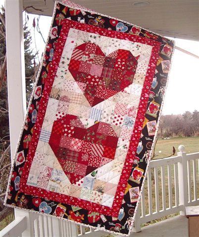 Heart Banner Quilt designed by Nanette Breton Merrill of Freda's Hive