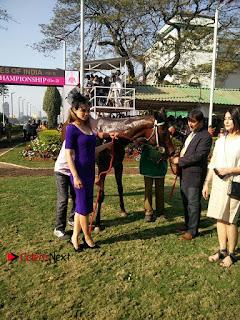 Bollywood Actress Kangana Ranaut Stills in Purple Short Dress at the Derby  0005.jpg