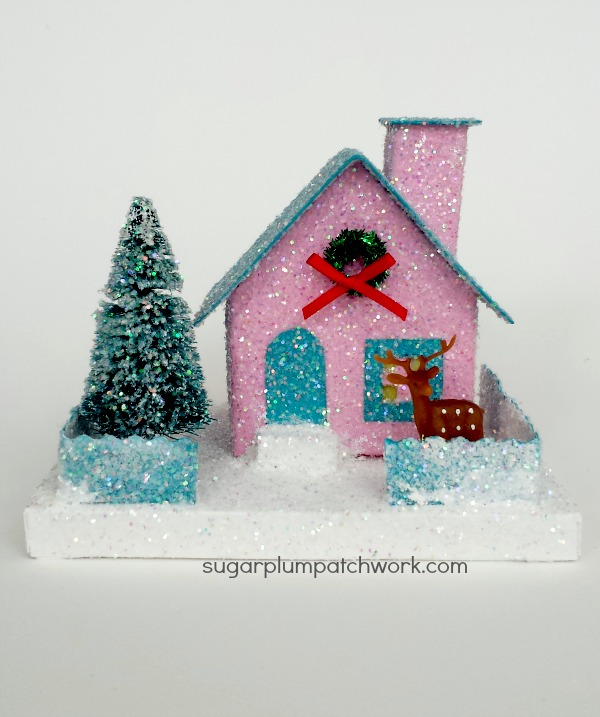pink glitter house with tree and deer