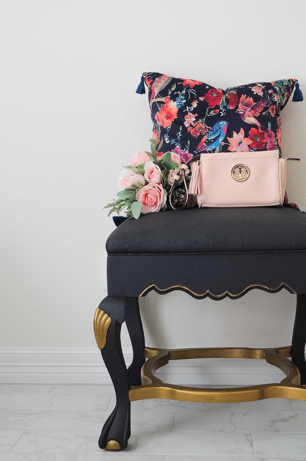 A thrifted ottoman gets up cycled with black paint and gold finishes. Even the fabric is painted- what a gorgeous DIY makeover. | #DIY #decor #painting #paintedfurniture #furnituremakeover #upcycled #thriftscore #antiques #ottoman #glamdecor #tutorial #bedroomideas