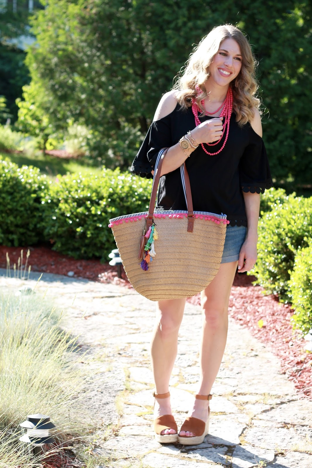 black cold shoulder top, jean shorts, tassel straw tote, steve madden wedge sandals, pink statement necklace, second trimester, summer maternity outfit
