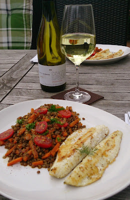 A dish with fish and lentils together with a Pinot Blanc aka Weissburgunder