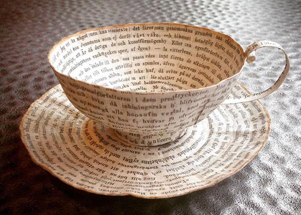 Libros viejos reutilizado en el delicado arte de papel por Cecilia Levy