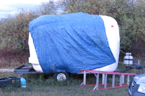 trailer covered with tarp