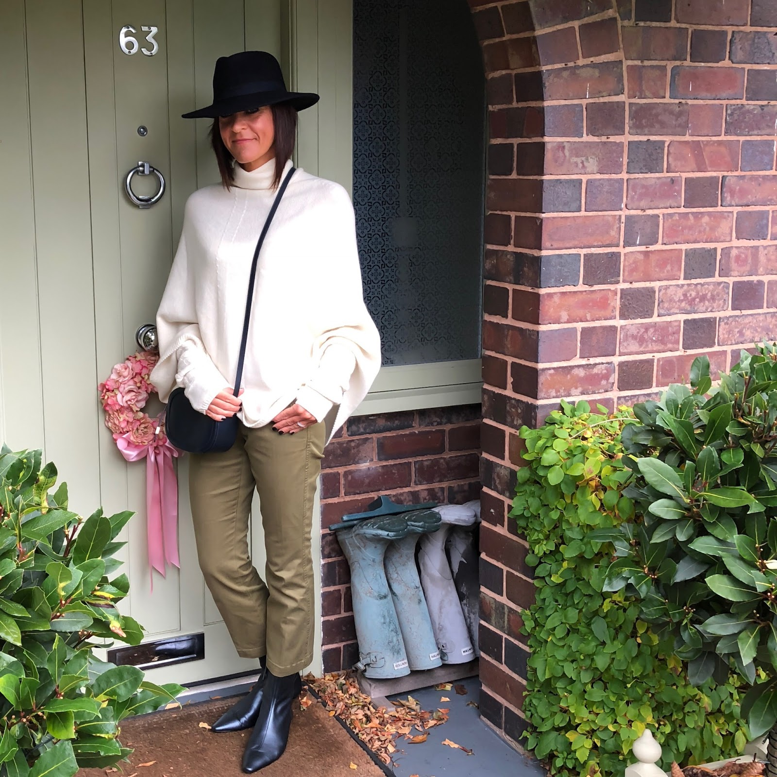 my midlife fashion, italy in cashmere cream white pure cashmere cable knit wrist warmer gloves, italy in cashmere cream white pure cashmere roll neck poncho cape, zara sock boot kitten heel ankle boots, iris and ink leather shoulder bag, j crew sammie cropped kick flare chinos, hobbs navy fedora felt hat