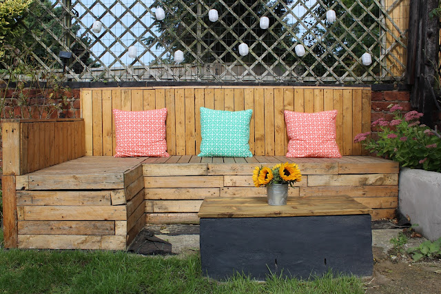 pallet seating in garden with coffee table